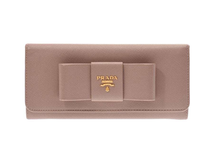 e5449d472e15 ... レディースサフィアーノABランクPRADAギャラ銀蔵 リボンモチーフがキュートなデザインのプラダ?ファスナー長財布。  カードポケットは10個、フリーポケットも ...
