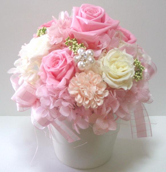 The pink sinter which dresses stylishly in a hand on a flower gift wedding  present marriage memory present gift memorial day on a celebration of ...