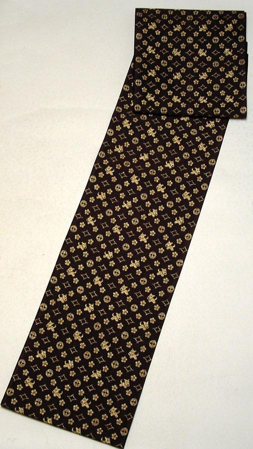 西陣正絹袋帯 未仕立てとっても可愛い犬・ワンちゃん柄こげ茶×金 103