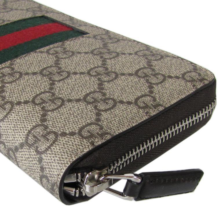387b25c373c3 GGアイコンが全体に配されたGGスプリームキャンバスにウェビングラインを施した上品な印象のラウンドファスナー長財布