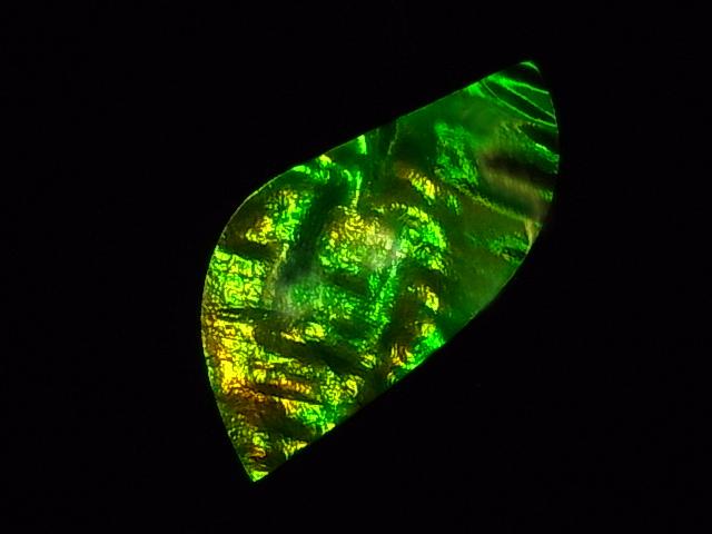 新品■送料無料■ 約7000万年前の神秘が宿るカナダ産化石宝石 アンモライト アンモナイト実物稀少化石 トラスト アンモライトハイグレードナチュラルルース