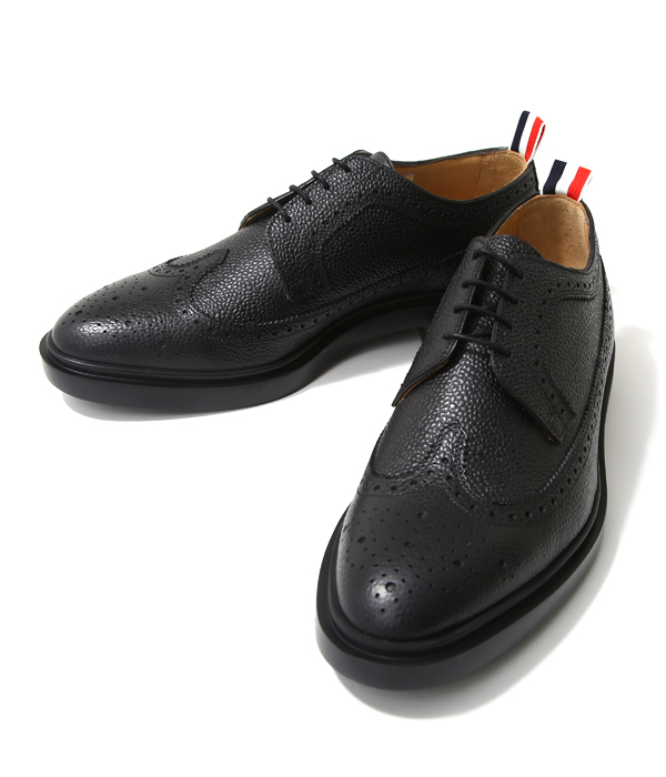 fae060ad78 It is basic wing tip leather shoes to be able to call one of the  masterpieces of THOM BROWNE. The sole adopts lightweight injection sole  using THOM BROWNE ...
