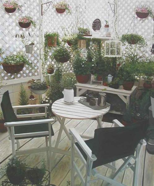 特価油絵 ウッドデッキの白いテーブル