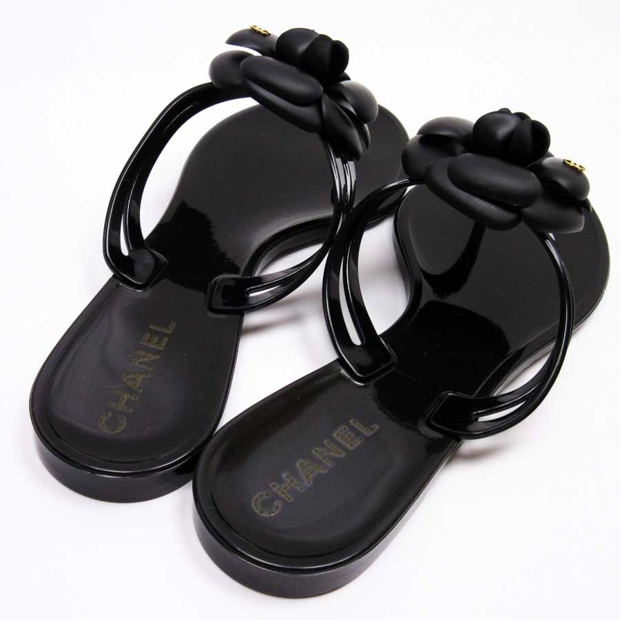 5a51b0811 It is Chanel  CHANEL  camellia here mark sandals (38) Lady s black rubber   as well as a new article   used