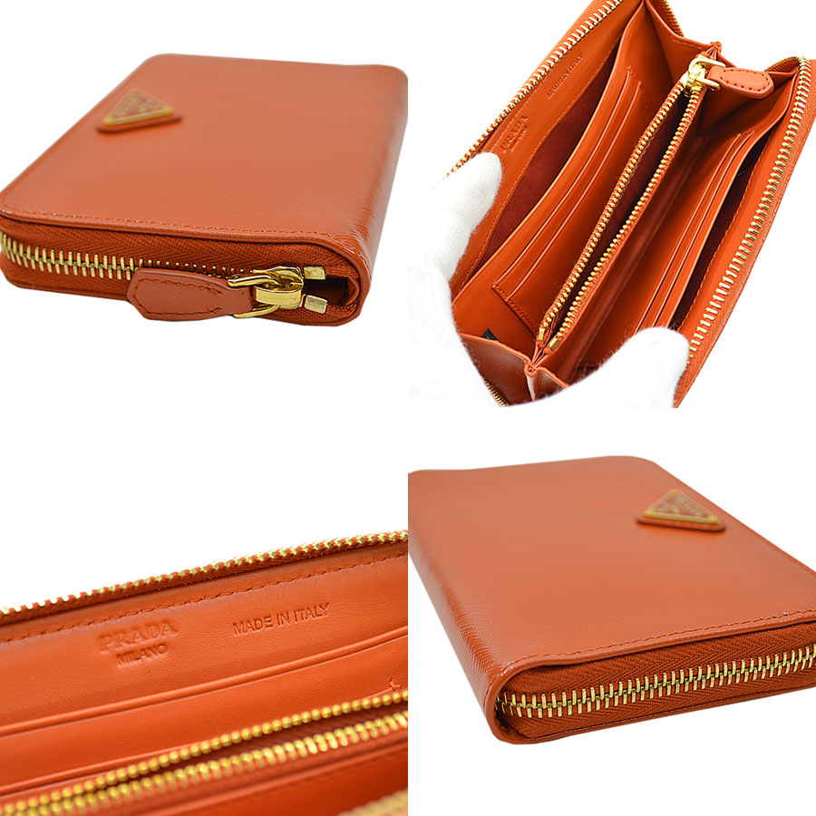249d99dcac5f プラダのラウンドファスナー財布です。正面にはしっかりとブランドロゴ入り、オレンジ がお洒落な逸品です。コンパクトな作りですが、収納スペースもありお勧めです。