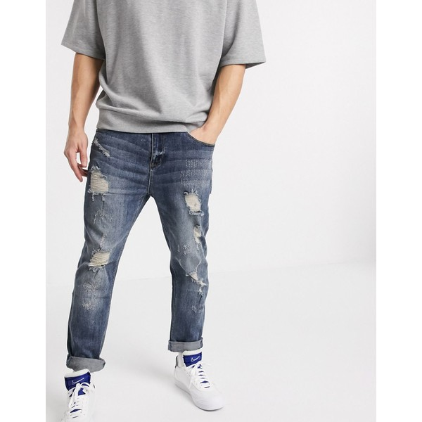 エイソス メンズ デニムパンツ ボトムス ASOS DESIGN relaxed tapered jeans in dark wash blue with heavy rips Dark wash blue