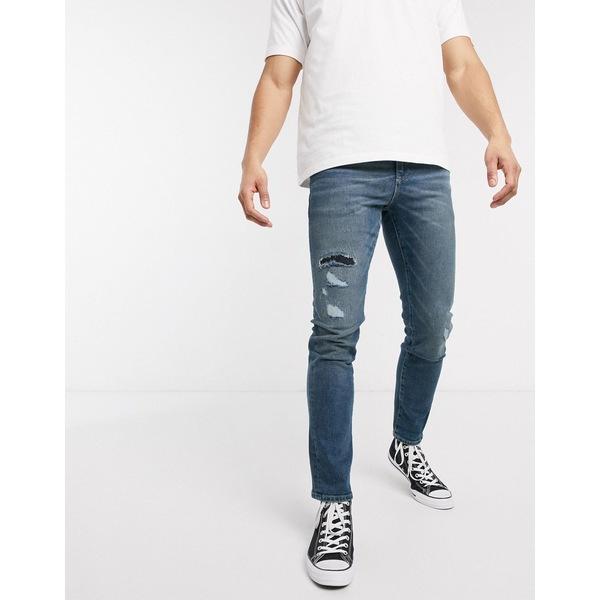 エイソス メンズ デニムパンツ ボトムス ASOS DESIGN 12.5oz slim jeans in vintage mid wash blue with rip and repair Mid wash blue