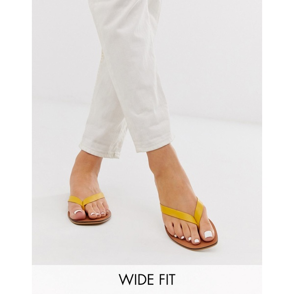 エイソス レディース サンダル シューズ ASOS DESIGN Wide Fit Florence leather flip flop sandals in yellow Yellow