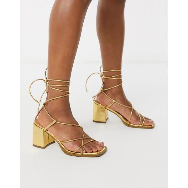 エイソス レディース サンダル シューズ ASOS DESIGN Hideout block heeled minimal strap sandals in gold Gold