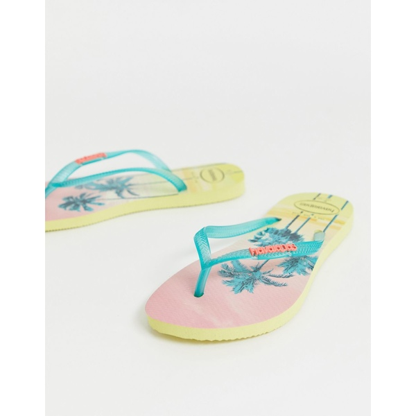 ハワイアナス レディース サンダル シューズ Havaianas slim flip flops in tropical palm print Pollen yellow