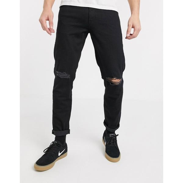 エイソス メンズ デニムパンツ ボトムス ASOS DESIGN stretch tapered jeans in black with knee rips Black