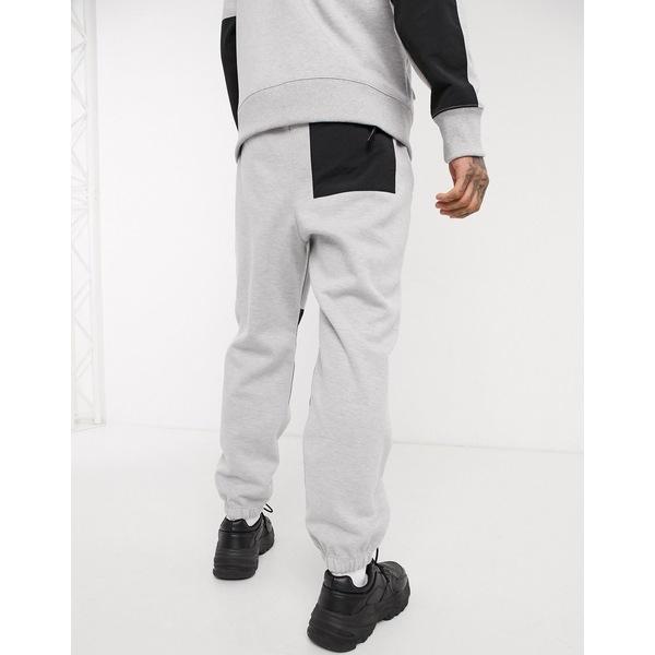 ノースフェイス メンズ カジュアルパンツ ボトムス The North Face Graphic Collection fleece pant in gray Tnf light gray heath