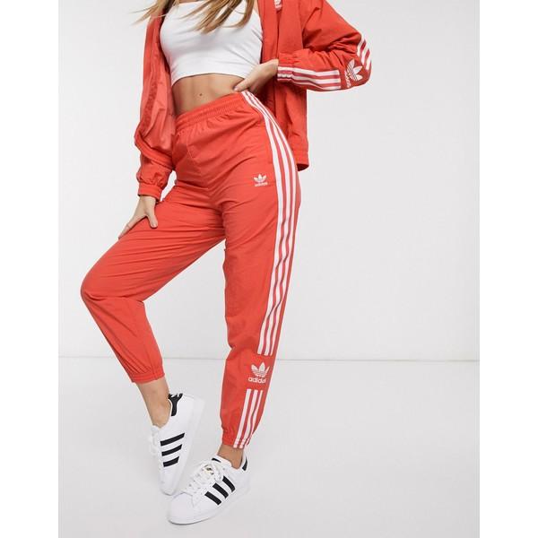 アディダスオリジナルス レディース カジュアルパンツ ボトムス adidas Originals adicolor locked up logo track pants in red Red