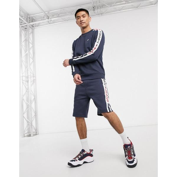 トミーヒルフィガー メンズ カジュアルパンツ ボトムス Tommy Jeans branded side taping sweat shorts in navy Twilight navy