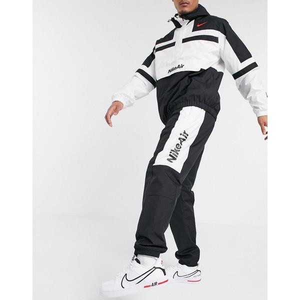 ナイキ メンズ カジュアルパンツ ボトムス Nike Air cuffed woven sweatpants in black Black
