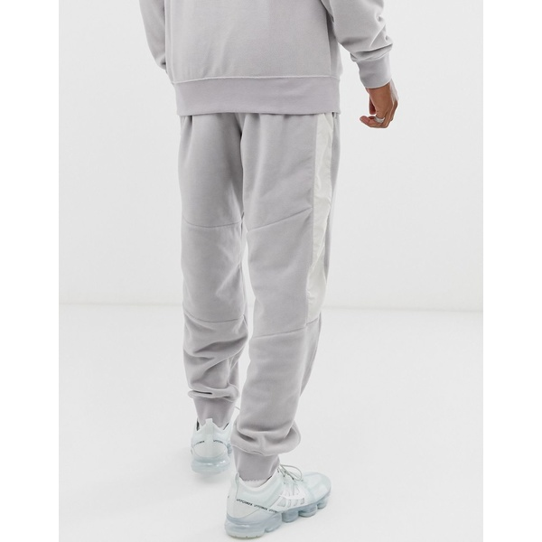ナイキ メンズ カジュアルパンツ ボトムス Nike winter cuffed sweatpants with nylon panels in gray Gray