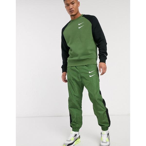 ナイキ メンズ カジュアルパンツ ボトムス Nike Swoosh cuffed woven sweatpants in khaki Khaki