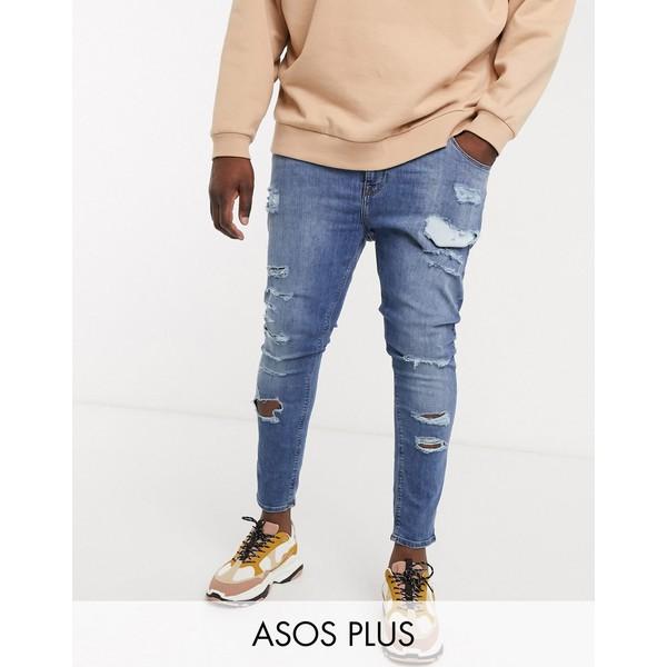 エイソス メンズ デニムパンツ ボトムス ASOS DESIGN Plus spray on jeans in power stretch denim in mid wash blue with heavy rips Mid wash blue