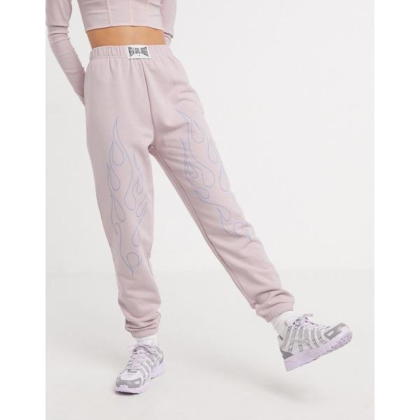 ニューガールオーダー レディース カジュアルパンツ ボトムス New Girl Order oversized sweatpants with flame outline two-piece Pale pink
