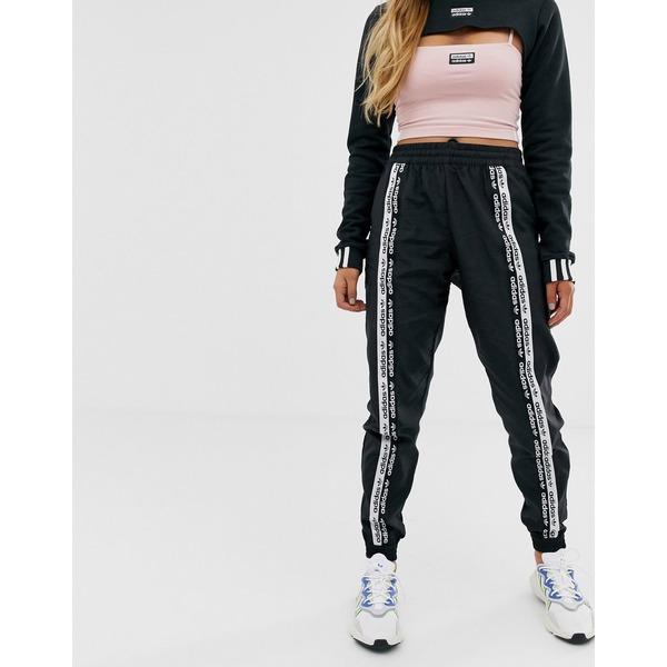 アディダスオリジナルス レディース カジュアルパンツ ボトムス adidas Originals RYV taping track pants in black Black
