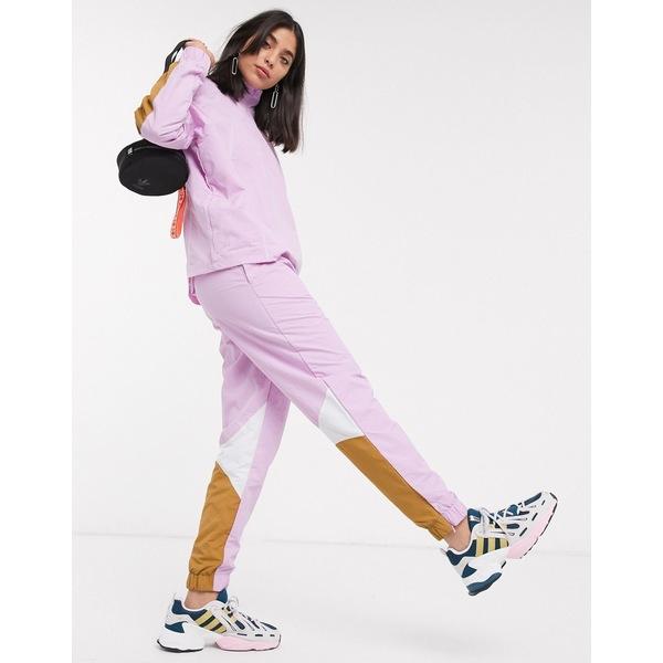 アディダスオリジナルス レディース カジュアルパンツ ボトムス adidas Originals Bellista track pants in lilac Clear lilac