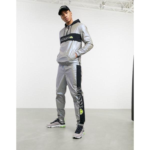 エレッセ メンズ カジュアルパンツ ボトムス ellesse x Smiley Ranieri reflective trackpants in gray Iridescent