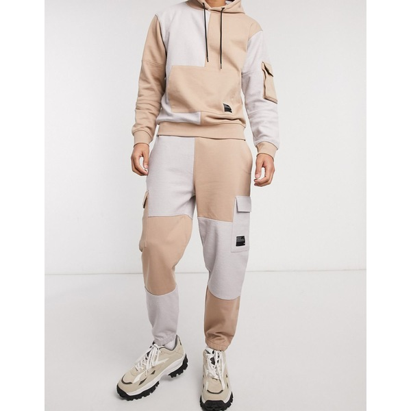 メンナス メンズ カジュアルパンツ ボトムス Mennace two-piece utility patch sweatpants in tan Tan