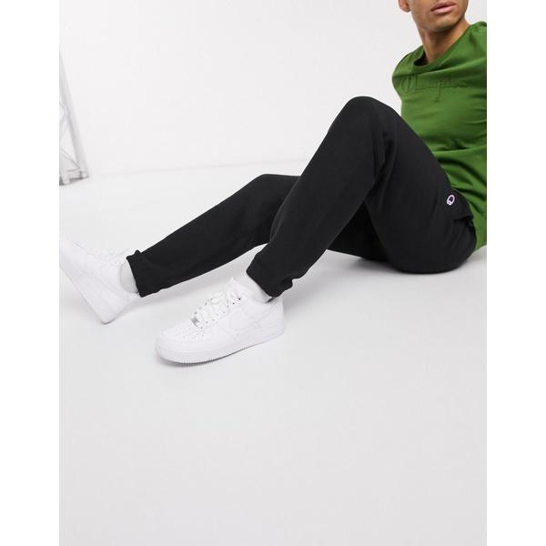チャンピオン メンズ カジュアルパンツ ボトムス Champion sweatpants with elastic cuffs in black Black nbk