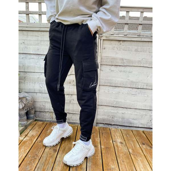クチュールクラブ メンズ カジュアルパンツ ボトムス The Couture Club rubber badge definition cargo sweatpants in black Black