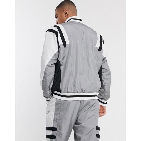 ナイキ メンズ ジャケット&ブルゾン アウター Nike Re-Issues woven track jacket in gray Gray