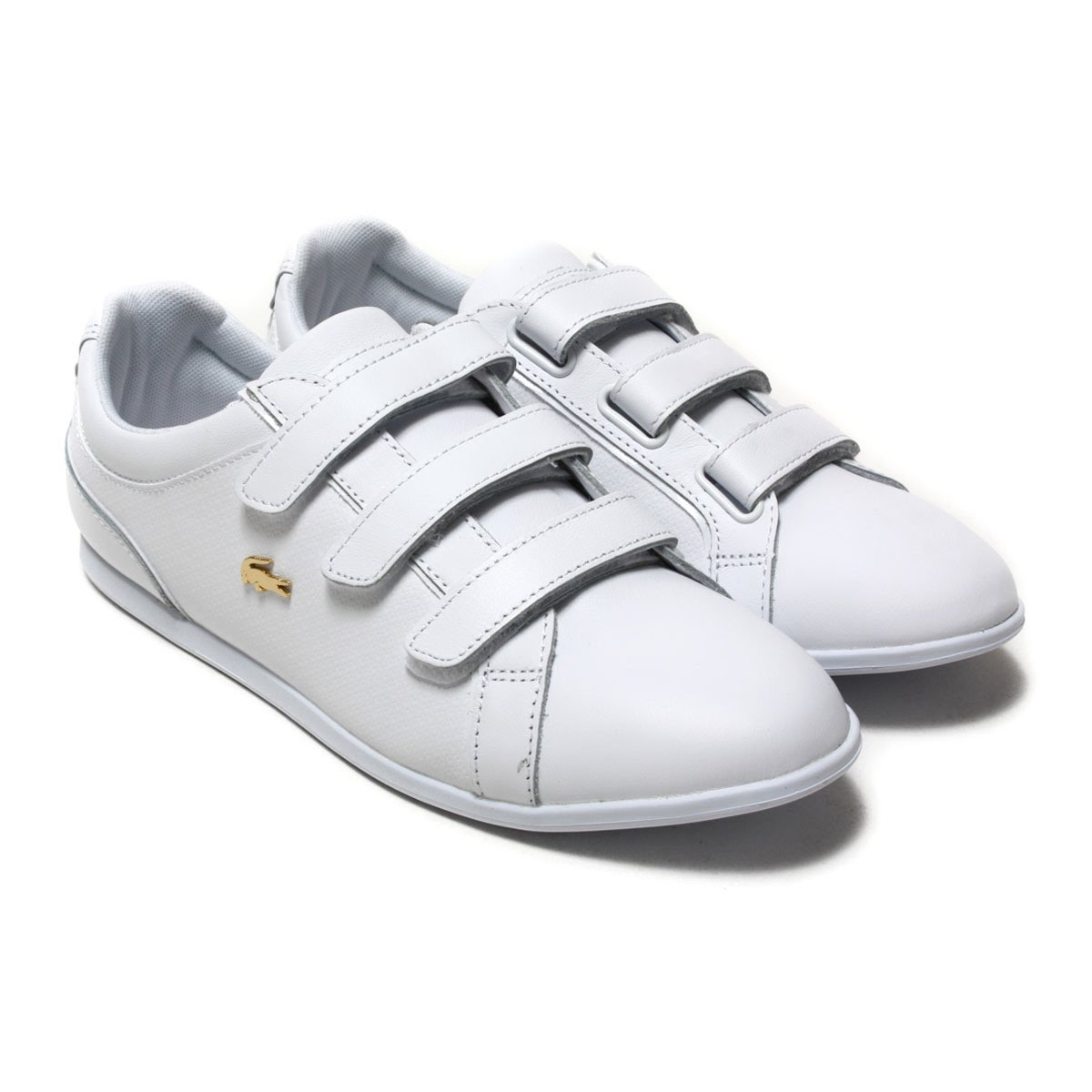 0cb306bce The upper leather which worked of the emboss is traditional graphic of  Lacoste. The low profile sneakers for the woman ...