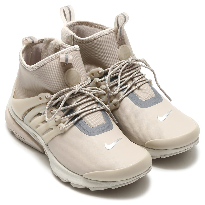 innovative design 698e7 79284 Nike Womens air Presto mid utility, arrange the iconic shoes for winter.  Adopt water resistant stretch synthetic textile upper.