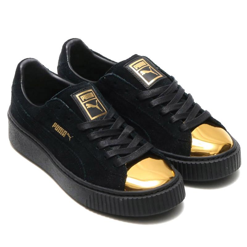 black n gold pumas