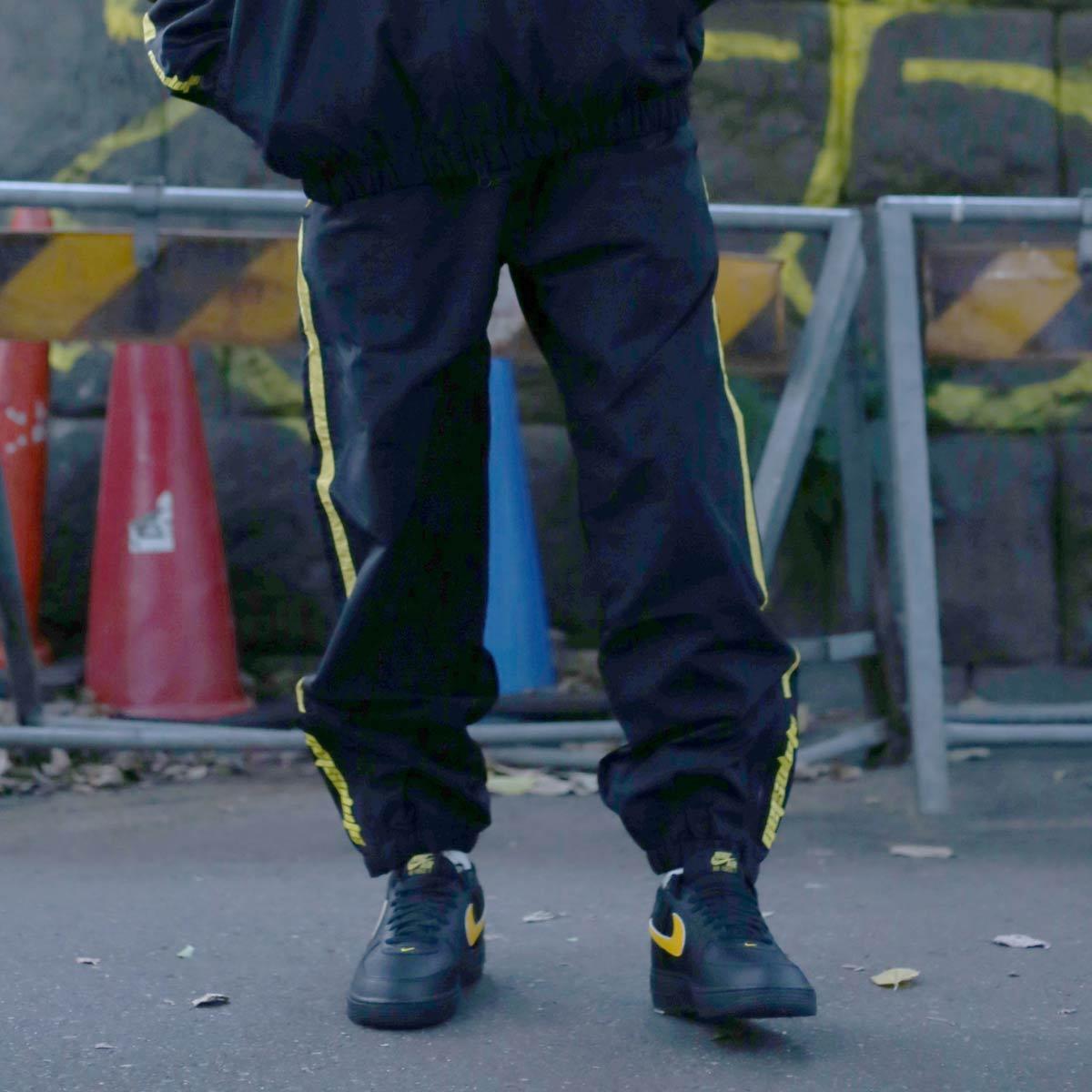 ATMOS LAB NYLON TRACK LINE PANTS (アトモスラボ ナイロン トラック ライン パンツ) BLACK/YELLOW【メンズ ナイロンパンツ】17HO-I