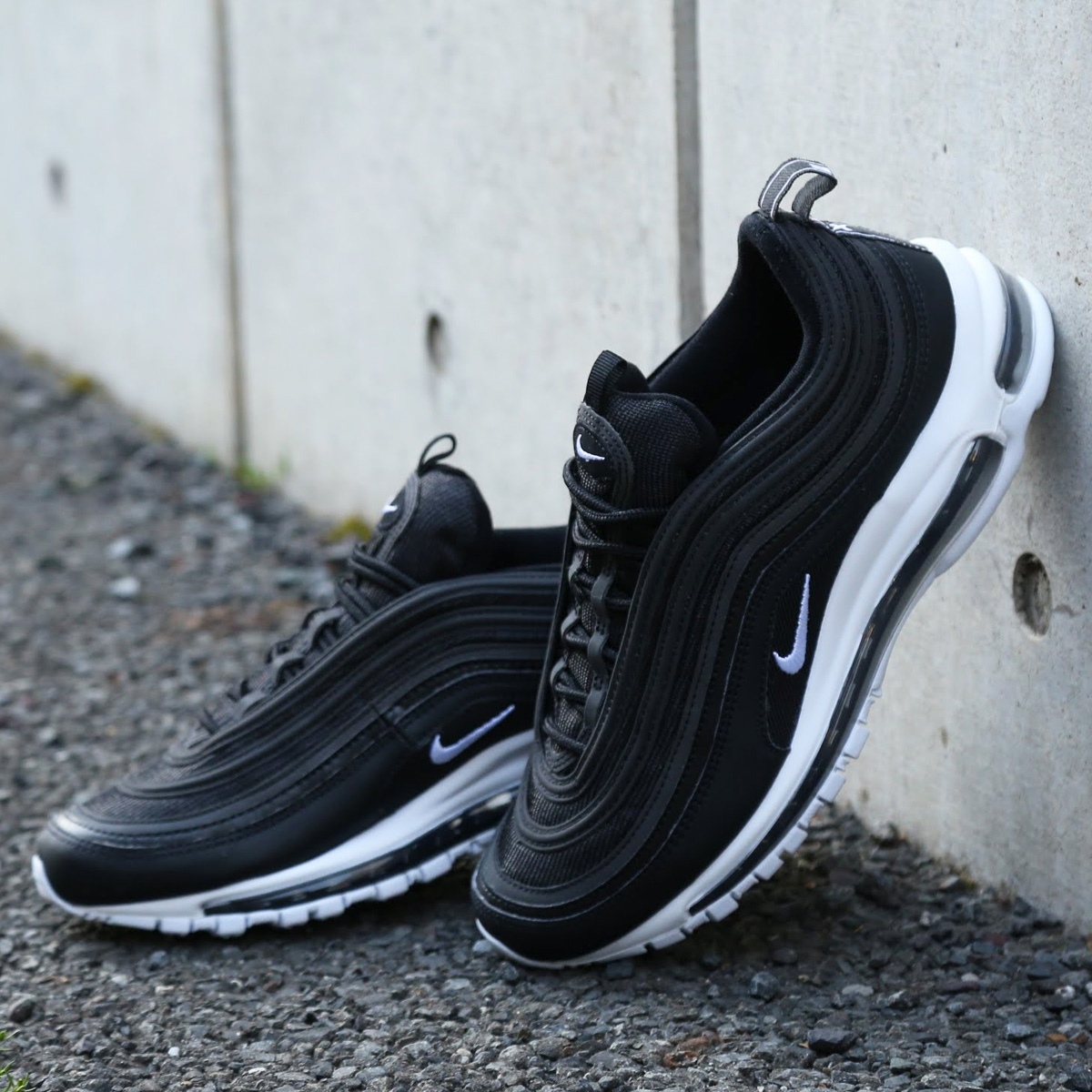 black white and green air max 97