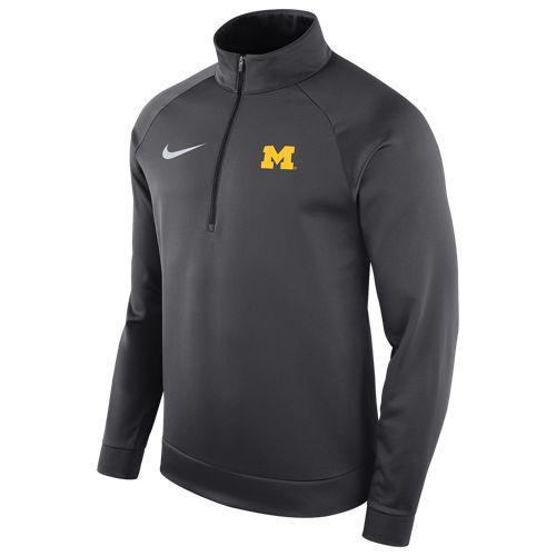 (取寄)ナイキ メンズ カレッジ サーマ ロングスリーブ 1/2 ジップ トップ ミシガン ウルバリンズ Nike Men's College Therma L/S 1/2 Zip Top ミシガン ウルバリンズ Anthracite