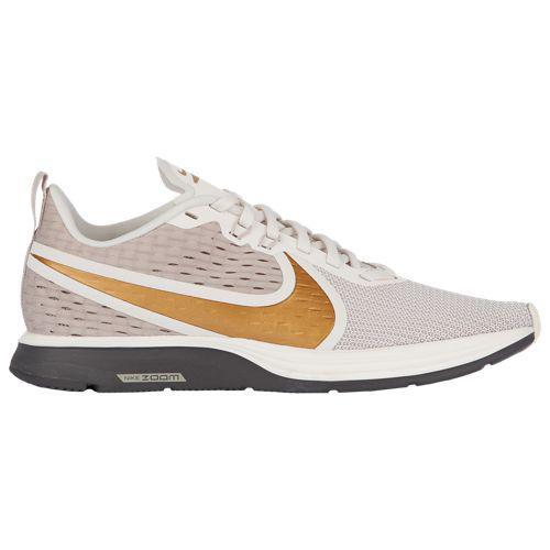(取寄)ナイキ レディース ズーム ストライク 2 Nike Women's Zoom Strike 2 String Mtlc Gold Phantom Thunder Grey