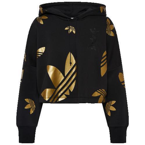 (取寄)アディダス レディース オリジナルス スペース テック クロップ ロゴ フーディ Women's adidas Originals Space Tech Crop Logo Hoodie Black Gold Metallic
