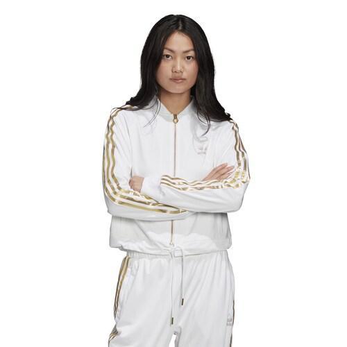 (取寄)アディダス レディース オリジナルス スーパースター 50 トリコット トラック トップ 2.0 Women's adidas Originals Superstar 50 Tricot Track Top 2.0 White Metallic Gold