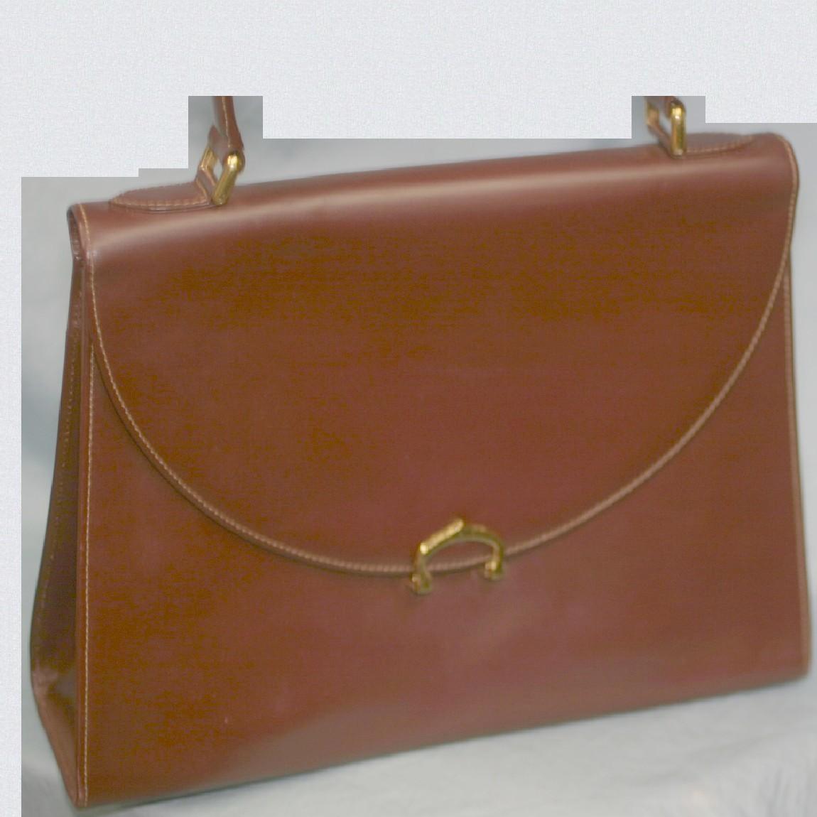 【中古】本物綺麗カルティエ女性用ボルドー色革台形31センチお洒落なハンドバッグ