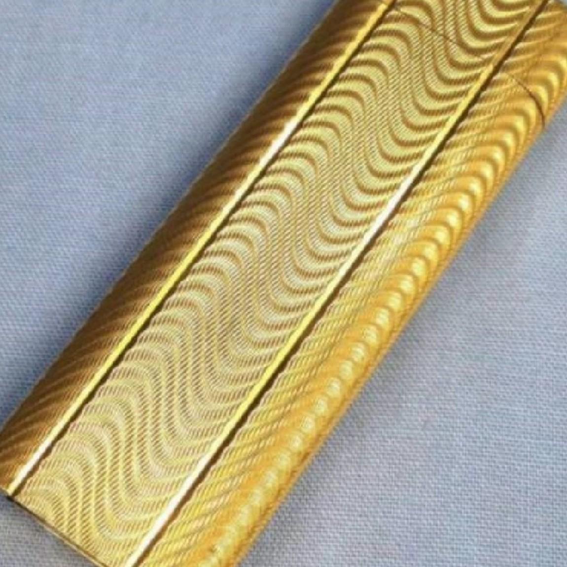 【中古】本物完動美品カルティエ7cm楕円金色横波型模様お洒落なライター○D9-107