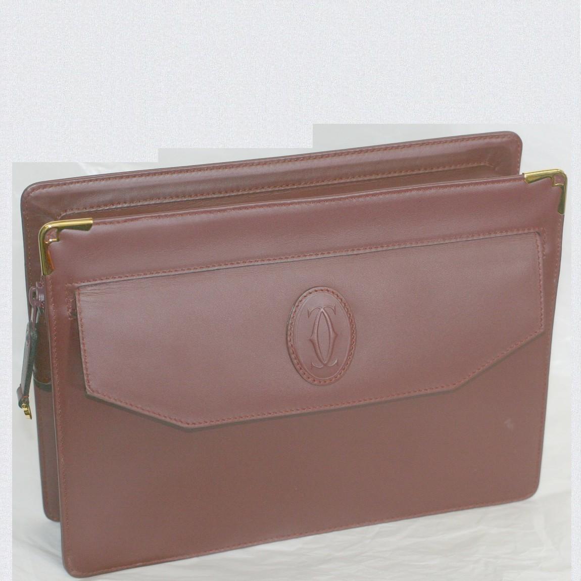 【中古】本物美品カルティエ男女兼用ボルドー色革素材セカンドバッグ兼クラッチバッグ サイズW26H20D5,5cm