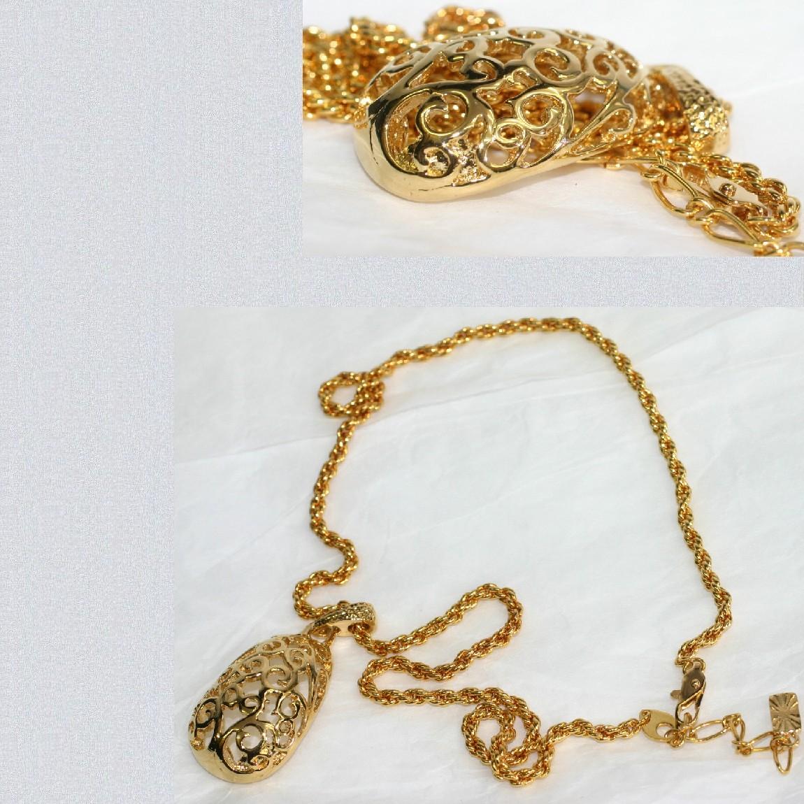 【中古】本物新品同様イヴ・サンローラン女性用金色金具彫り抜き楕円形金色大きいトップのついたチェーンネックレス重さ24,9g プレゼントに最適です