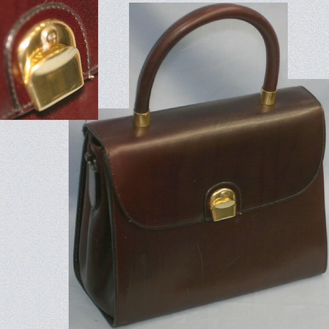 【中古】本物美品でレア焦げ茶色革素材女性用取り外し可能なショルダーストラップ付き斜め掛け可能24センチハンドバッグ