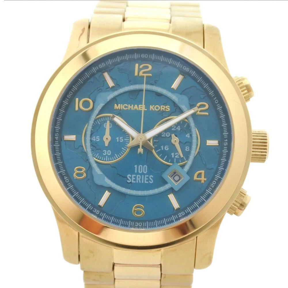 【Michael Kors】マイケルコース チャリティーウォッチ 100シリーズ MK-8315 ステンレススチール ゴールド クオーツ メンズ 青緑文字盤 腕時計【中古】Aランク