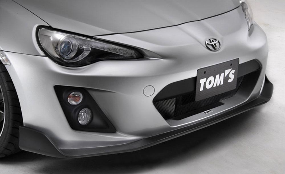 TOM'S フロンバンパー・Racing FOG有 ピュアレッド(M7Y) 86 ZN6 2012/4~2016/7 GT/GT-Lグレード 個人宅配送不可 沖縄・離島は送料着払い