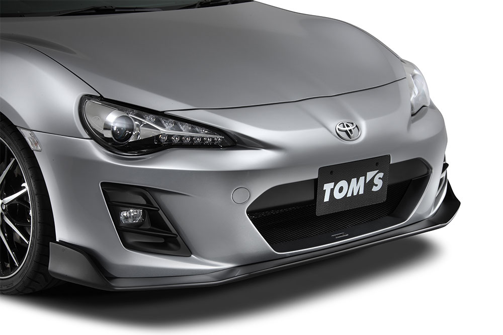 "TOM'S フロンバンパー・""Racing MC後FOG有 クリスタルホワイトパール(K1X) 86 ZN6 2016/7~ GT/GT-Lグレード 個人宅配送不可 沖縄・離島は送料着払い"