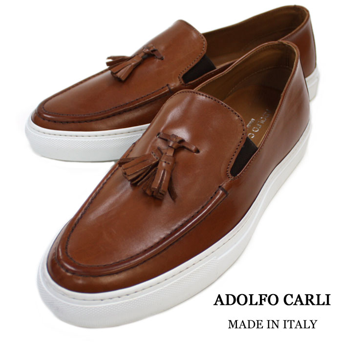 MADE IN ITALY leather sneakers. The leather sneakers of the adult face whom  a dress shoes factory deals with. Slip-ons sneakers-style of the dress  sense now ... e543fc039216