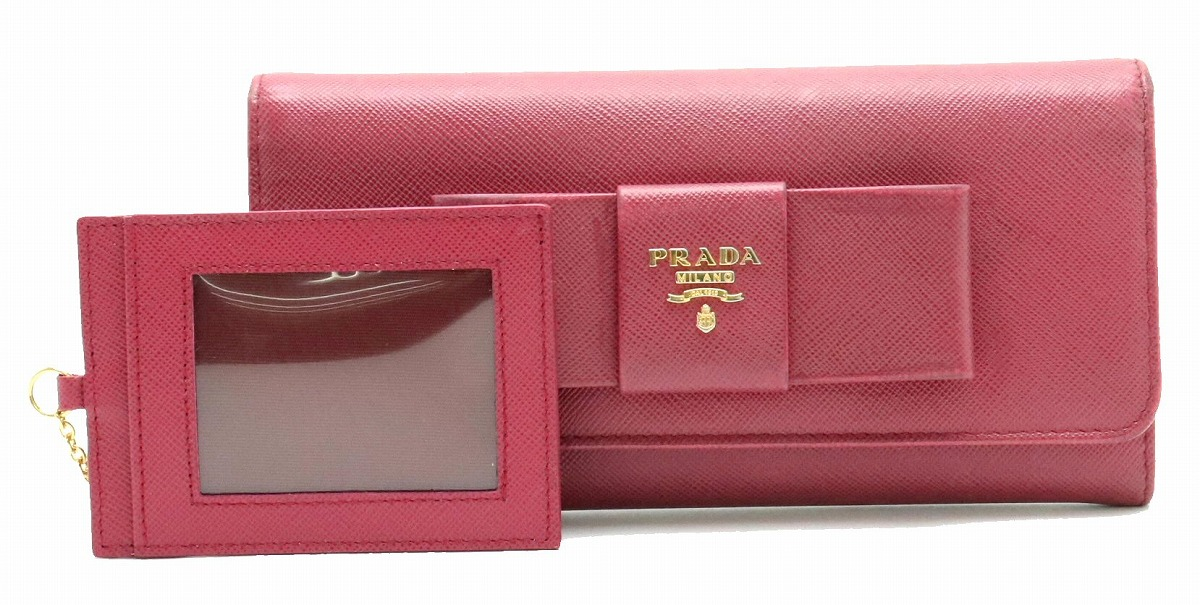 【財布】PRADA プラダ ラウンドファスナー リボン 長財布 型押しレザー IBISCO ピンク ゴールド金具 パスケース付き 国内ブティック購入品 1M1132 【中古】