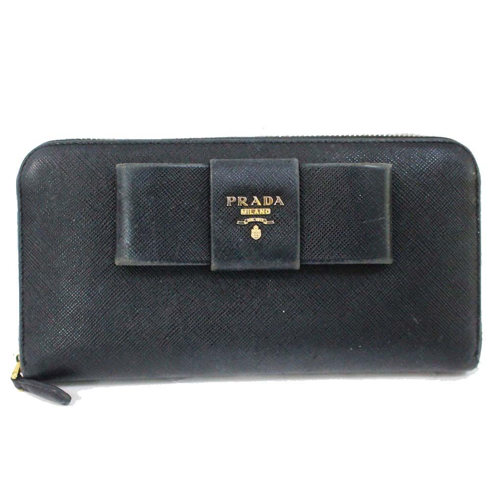 【中古】PRADA プラダ ラウンドファスナー リボン 長財布 レディース ブラック ゴールド金具 型押しレザー 1ML506